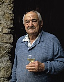 Wine-grower Alexis Guirouilh with a glass of moelleux, Jurancon, France