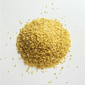 A heap of bulgur against a white background