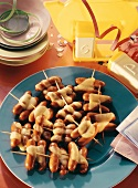 Cocktail sausages on sticks for a 50s party