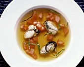Fish Soup with Oysters and diced Tomato