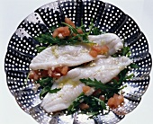Turbot fillets with arugula & tomatoes in a steamer