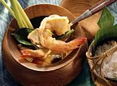 Shrimp Soup with Lemon Grass in a Wooden Bowl