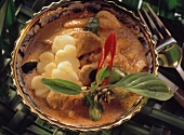 Chicken curry with pineapple in small bowl