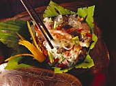 Shrimp Salad with Chinese Noodles on Leaves in a Bowl