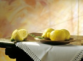 Lemons on a Table; One Sliced
