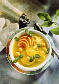 Lime soup with orange slices, kumquats, mango segments