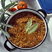 Ground Meat Sauce in a Pan with Fresh Sage