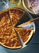 Leek tart in tart dish, a piece cut