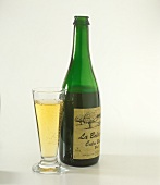 Bottle & glass of Cidre, the apple wine from western France