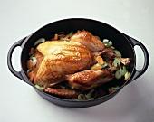 Whole roasted turkey on bed of carrots & leeks