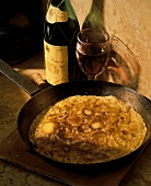Tortilla de Patatas: Potato Omelet in Skillet with red Wine