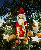 Chocolate Santa Clause with Nuts and Cookies; Greens