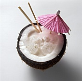 Pina Colada in a Coconut Half with a Cocktail Umbrella