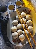 Sweet Rice Dumplings on a Platter with Chopsticks and Tea