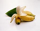 Unpeeled banana & peeled banana with banana leaf