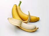 Two Bananas; One Partially Peeled
