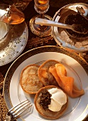 Three blinis with caviare, sour cream & smoked salmon