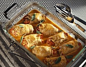 Veal stuffed with vegetables in a roasting pan