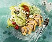Sliced pork Wellington with raw vegetable salad