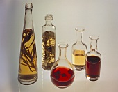 Several types of vinegar: tarragon, herb, raspberry, wine