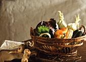 Assorted Vegetables in a Basket; String of Garlic