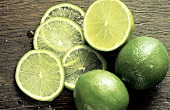 Two Whole Limes; Lime Half and Lime Slices