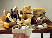 Large Assorted Cheese Still Life with Wine; Grapes