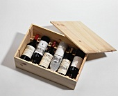 French red wine bottles in a wooden case
