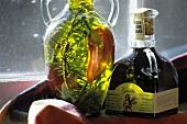 Bottle of olive oil, fresh thyme & pepper & gaeta vinegar