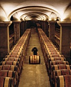 Rolling a Barrel of Wine in a Cellar