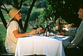 Couple drinking wine in the Napa Valley, California