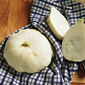 Two White Pumpkins on a Dish Towel