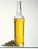 A Bottle of Sunflower Oil with Sunflower Seeds