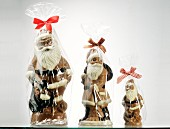 Three packed chocolate Father Christmases