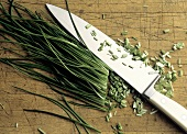 Partially Chopped Chives with a Knife