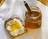 A Piece of Toast with Butter and Honey; Honey in a Jar