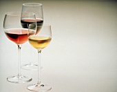 Glass of white wine, glass of rose wine and glass of red wine