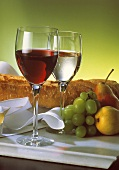 A Glass of Red and White Wine with a Loaf of Bread