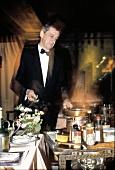 Waiter Preparing Flambee in a Restaurant
