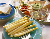 White asparagus with tomato sauce, avocado mousse & egg sauce