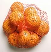 Mandarins in net (lying)