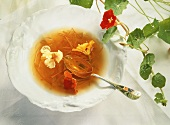 Vegetable stock with julienne carrots & nasturtium flowers