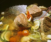 Meat broth with vegetables and beef fillet