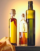 Three different bottles of olive oil