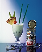 A pina colada and an opened tin of cream of coconut