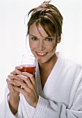 Young woman with a glass of tomato juice