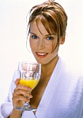 A Woman with a Glass of Orange Juice