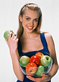 A Woman Holding a Bowl of Apples