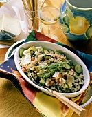 Vegetable risotto with courgettes, mushrooms & tomatoes in bowl