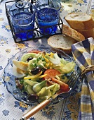 Mixed vegetable salad with eggs, olives & anchovy fillets
